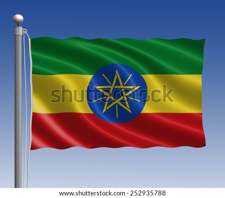 Ethiopia flag in pole on blue sky background