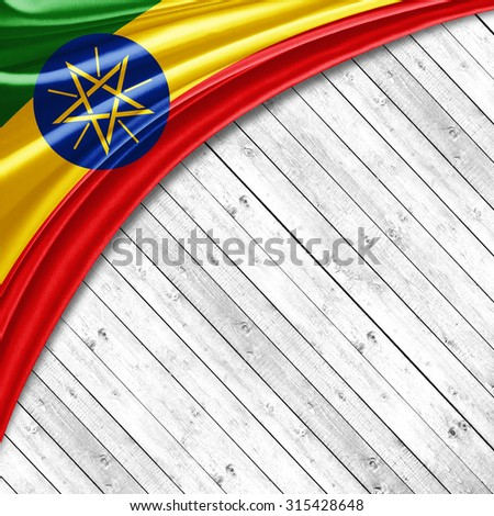 Ethiopia flag   of silk with copyspace for your text or images and wood background - stock photo