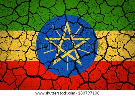 Ethiopia flag on a cracked ground - stock photo