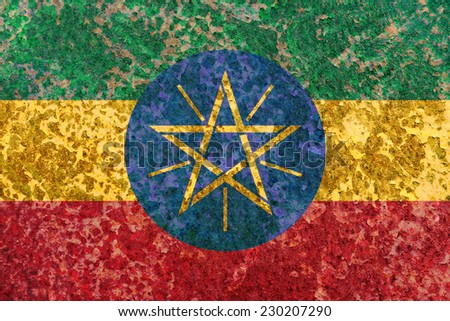 Ethiopia flag on old rusty metal background - stock photo