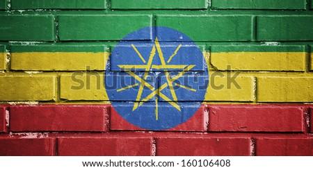 Ethiopia flag on texture brick wall - stock photo