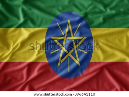 Ethiopia  flag  on the fabric texture background - stock photo