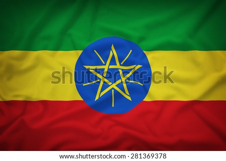 Ethiopia flag on the fabric texture background,Vintage style