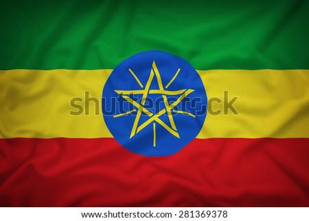 Ethiopia flag on the fabric texture background,Vintage style - stock photo