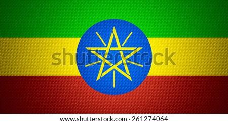 Ethiopia flag or Ethiopian banner on abstract texture - stock photo