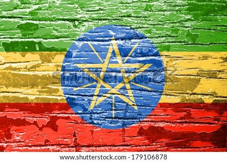 Ethiopia Flag painted on grunge wood background  - stock photo
