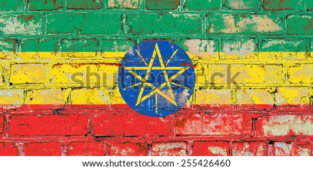 Ethiopia flag painted on old brick wall texture background - stock photo