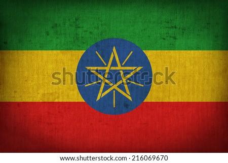 Ethiopia flag pattern on the fabric texture ,retro vintage style - stock photo