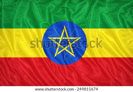 Ethiopia flag pattern on the fabric texture ,vintage style - stock photo