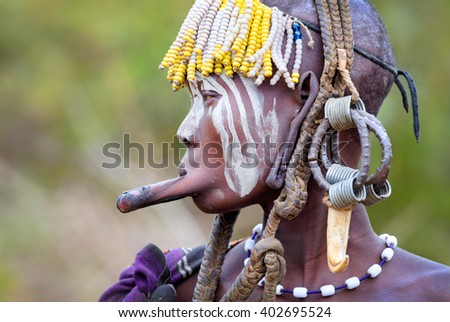 Ethiopia, Omo valley, november 18, 2013 Woman Mursi tribe - stock photo