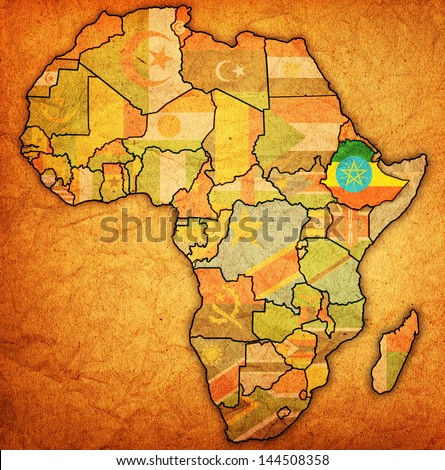 ethiopia on actual vintage political map of africa with flags - stock photo