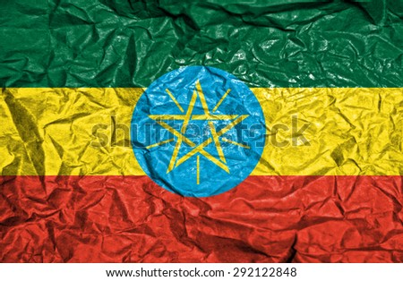 Ethiopia vintage flag on old crumpled paper background - stock photo