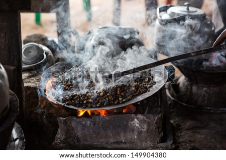 Ethiopian coffee roasted in a traditional way  - stock photo