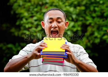 ethnic asian male student hungry of knowledge education