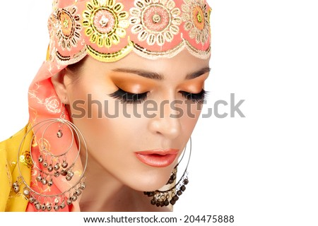 Ethnic beauty. Beautiful hindu woman with traditional clothes, jewelry and makeup. Closeup portrait isolated on white - stock photo