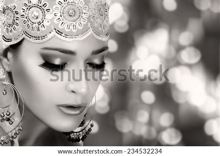 Ethnic Beauty Fashion. Closeup hindu face woman with traditional clothes, jewelry and makeup. Monochrome portrait with copy space for text - stock photo