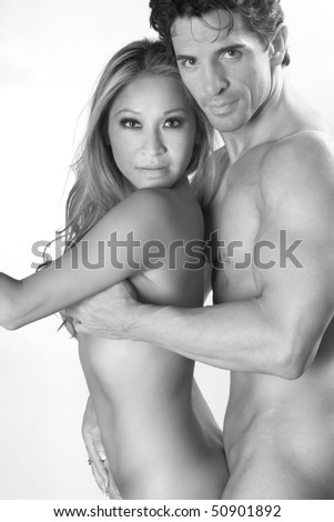 ethnic couple in love, Caucasian man hugging his Asian lover or wife - stock photo