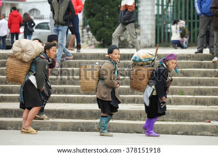 ethnic minorities at Sapa, Laocai province, Vietnam on JAN 1, 2015. Sapa is travel town,it is one of the main market towns in the area, where several ethnic minority groups - stock photo