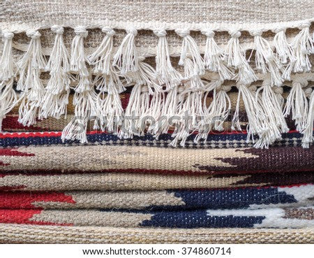 Ethnic textile with fringes and tassels for your decoration of home interior - cultural tradition in Ukraine. - stock photo
