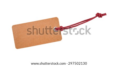 Etiquette with red ribbon isolated on white - stock photo