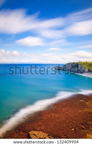 Etretat bay, aerial view from cliff. Normandy, France, Europe. Long exposure photography. - stock photo