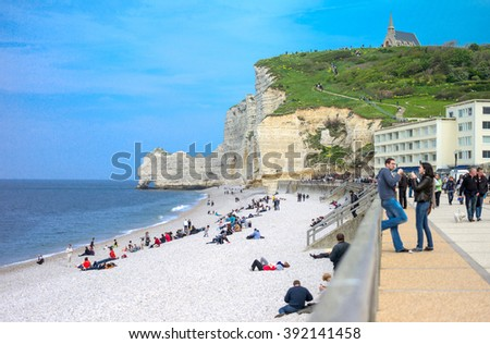Etretat, France - May 19, 2012: Normandy, local people relaxing on the beach near the cliffs .