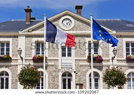 Etretat town hall. Etretat is a commune in the Seine-Maritime department in the Haute-Normandie region in northwestern France. Etretat is now a famous French seaside resort.