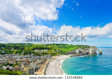 Etretat village, its bay beach and Aval cliff landmark. Aerial view. Normandy, France, Europe. - stock photo