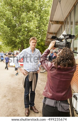 Etruria Canals Festival , Stoke On Trent, England, UK - Saturday 4th June 2016 Tristram Hunt Labour MP and Shadow Minister for Education talking to camera woman at the Etruria Canals Festival.