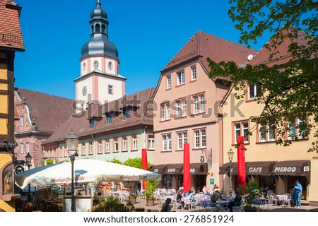 ETTLINGEN, GERMANY - APRIL 20, 2009: Church place with city hall and city hall tower in Ettlingen. The city Ettlingen is one of the gates to the Black Forest.