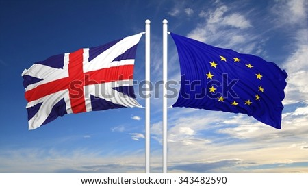 EU and British flags against of blue sky - stock photo