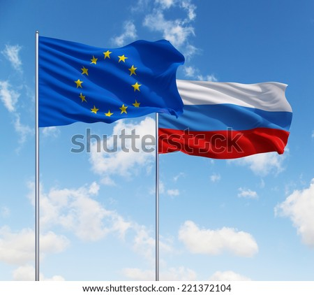 EU and Russian flags on a blue sky background. - stock photo