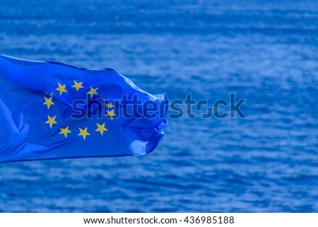 EU flag flying over the sea - stock photo