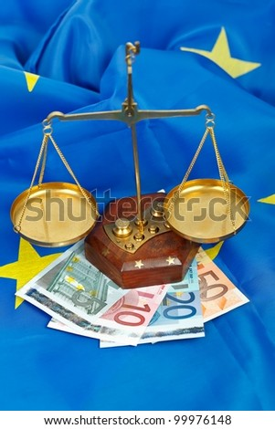EU flag with scale of balance and euros - stock photo
