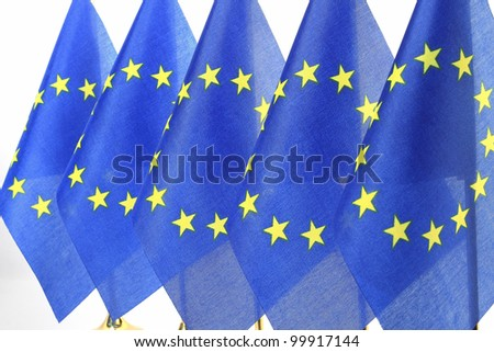 EU flags hanging in the queue of flagpole,Isolated on the white background - stock photo