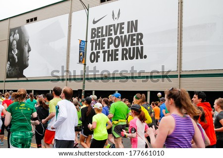 Eugene, OR - April 28: 2013 Eugene Marathon start with runners next to Historic Hayward Field at the University of Oregon with a Nike advertisement in the background on April 28, 2013 in Eugene, OR. - stock photo