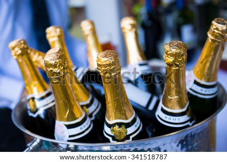 EUGENE, OR - AUGUST 2, 2014: Champagne bottles chilling in ice for a big toast at a wedding reception.