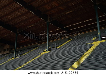 EUGENE, OR - August,22, 2014: Historic Hayward Field at the University of Oregon with workers prepping for a track and field competition. - stock photo