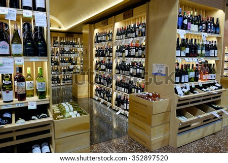EUGENE, OR - DECEMBER 16, 2015: Wine selection with custom wood shelves at Market of Choice, an upscale grocery store located in the Pacific Northwest.