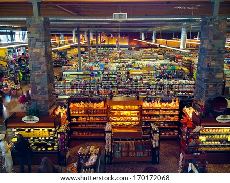 EUGENE, OR - JANUARY 3: Grocery store interior at Market of Choice in Eugene, OR on January 3, 2014. Market of Choice is a supermarket chain emphasizing organic and natural groceries. - stock photo