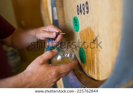 EUGENE, OR - JULY 17, 2014: Aged beer in this bourbon barrel at Oakshire Brewing, ready for a tasting. - stock photo