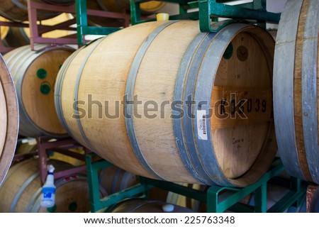 EUGENE, OR - JULY 17, 2014: Bourbon barrel aged beer aging in reused whiskey barrels at Oakshire Brewing. - stock photo
