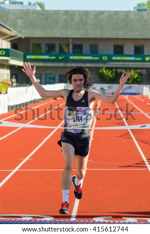 EUGENE, OR - MAY 1, 2016: Jimmy Grabow wins the half marathon with a time of 1:06:17 at the 2016 Eugene Marathon a USATF sanctioned Boston qualifier. - stock photo