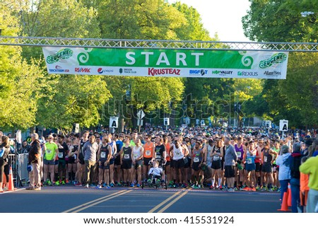 EUGENE, OR - MAY 1, 2016: Runners getting ready at the starting line ready to start the 2016 Eugene Marathon, a Boston qualifying event.
