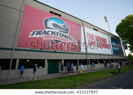 EUGENE, OR - MAY 1, 2016: Tracktown advertisement on the wall of Hayward Field next to the start of the 2016 Eugene Marathon, a Boston qualifying event.
