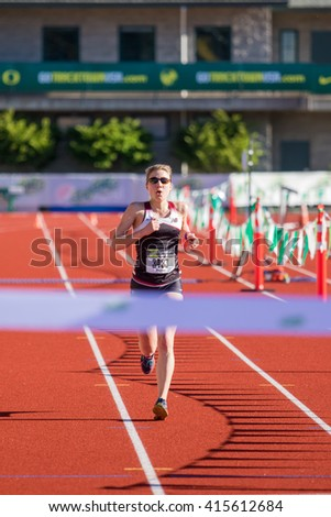 EUGENE, OR - MAY 1, 2016: Women's half marathon winner Christina Overbeck Crawford takes 1st place with a time of 1:18:52 at the 2016 Eugene Marathon a USATF sanctioned Boston qualifier. - stock photo
