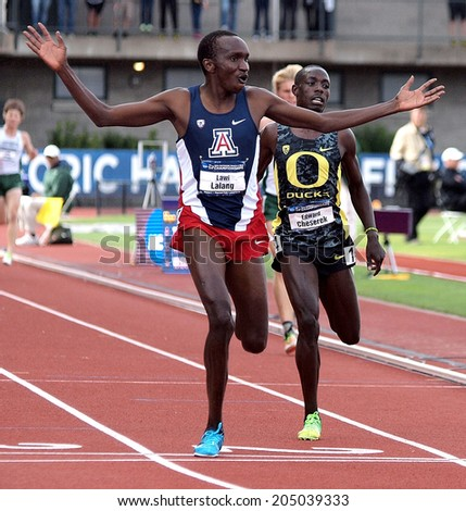 Eugene, Oregon June 12, 2014 - Arizona's Lawi Lalang crosses the finish line a step ahead of Oregon's Edward Cheserek in the men's 5000m race at the 2014 NCAA Track & Field Championships