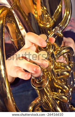euphonium being played by a child close up of fingers playing instrument