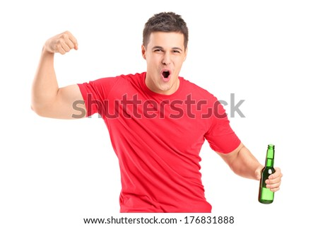 Euphoric fan holding a beer bottle and cheering isolated on white background - stock photo