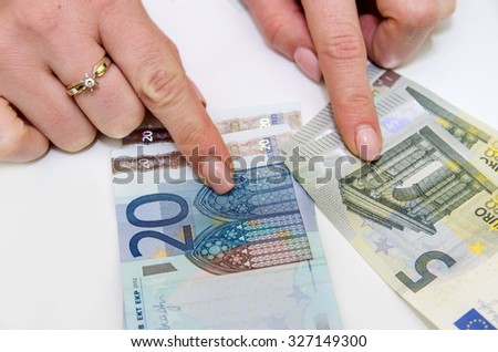 eupo banknotes in female hand, isolated - stock photo